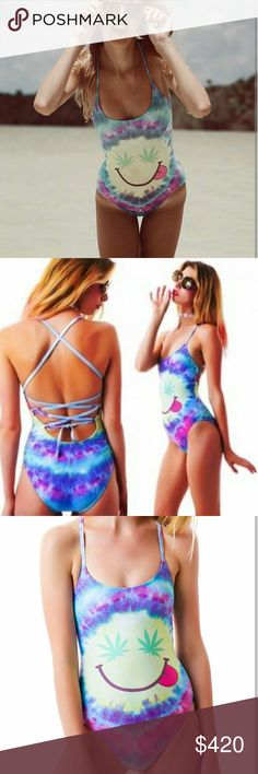 RARE WILDFOX mr.Nice guy swimsuit adjustable S *Offers welcomed*  Like new condition.   Very rare wildfox mr. Nice guy design featuring a marijuana eyed smiley face on vibrant purple pink and blue tye dye. Marked as a size small The back is fully adjustable to get your perfect fit. Wildfox Swim One Pieces