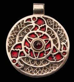 Anglo Saxon disc pendant based on a find from Faversham in Kent  with filligree pattern, red enamel and a central garnet surrounded by three stylised bird heads. Available in Gilded brass.