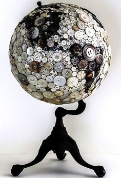 Find a old world map ball? Glue them with buttons, what a great statement piece in your room