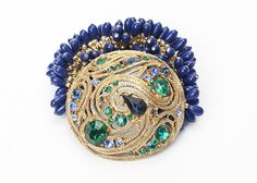 Paris Love Cures Bracelet --    Antique brooch created into a one of a kind stretch bracelet using vintage beads. A truly stunning piece of arm candy from our Wear a Bracelet, Find a Cure Campaign.
