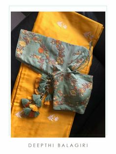 Blouse Designed by Designer Blouse Ideas . Tag your picture with to get featured on this page . Silk Saree Blouse Designs, Fancy Blouse Designs, Bridal Blouse Designs, Blouse Neck Designs, Saree Blouse Patterns, Grey Saree, Yellow Saree, Stylish Blouse Design, Designer Blouse Patterns