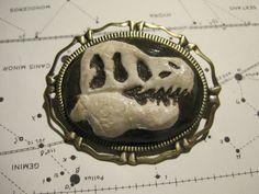 T. Rex Skull Cameo Brooch. $26.00, via Etsy.