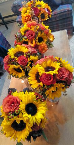 sunflowers, red roses, burlap, baby's breath