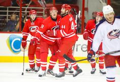 CrowdCam Hot Shot: Carolina Hurricanes right wing Alexander Semin is congratulated by teammate defensemen Jay Harrison after his first period goal against the Columbus Blue Jackets at PNC Center. Photo by James Guillory