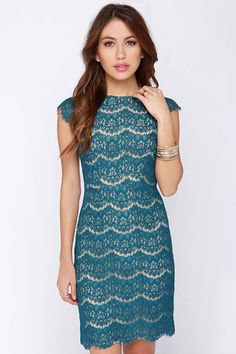 From the office to that upcoming cocktail party, the Darling Candice Teal Blue Lace Dress will remain your trusted companion! Delicate eyelash lace creates a jaw-dropping statement over a woven beige lining, and down a sleek sheath bodice with darted accents and sheer lace cap sleeves. The rounded neckline is complemented by a low scooping back with exposed antiqued brass zipper. Fully lined. Self: 43% Rayon, 29% Nylon, 28% Cotton. Lining: 100% Polyester. Dry Clean Only. Imported.