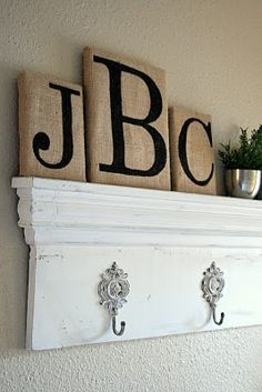 Love the burlap/painted letters. Plus, I love the shelf/hooks. I would like to recreate this - a project for down the road.