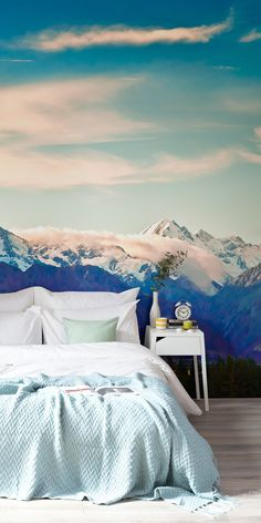 Lose yourself in this dreamy mountain landscape. This Everest wall mural is a myriad of soothing blues, with ice capped mountains and drifting clouds in the background. It's a match made in heaven with green interiors, and is perfect for creating calming bedroom spaces.