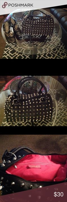 🍒💋 Depeche  Mode  Purse 🎒💄 This beautiful black leather studded purse is like new worn maybe twice..inside large zipper closure two side pocket deep in side of purse ...beautiful hot pink lining ,,,two leather straps on out side.. Depeche Mode Bags Shoulder Bags