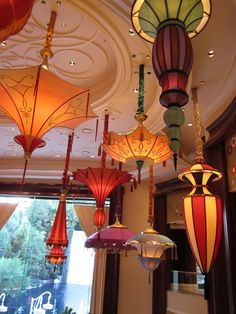 Wynn Las Vegas paper lanterns... now this is the way to do paper lanterns!  I think this could be recreated with a few uniquely shaped lanterns, and some beautiful paper parasols for a fraction of the price!