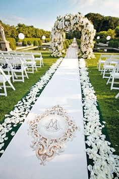 Dreamy Floral Wedding Aisle Details - Outdoor Wedding Flower Arch (BridesMagazine.co.uk)