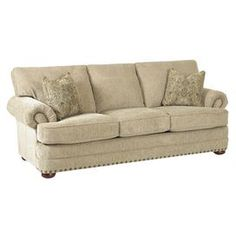 "A cozy addition to your living room or den, this classic sofa showcases roll arms and bold nailhead trim. Made in the USA.   Product: Sofa Construction Material: Wood and fabric Color: Caramel Features:Roll arms Nailhead trim Accent pillows includedMade in the USA Note: Accent pillows not included Dimensions: 39"" H x 92"" W x 39"" D"