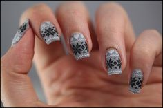 Fuzzy gray sweater nails with white and black stamping.