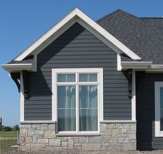 modern exterior paint colors for houses | brown trim, stone houses