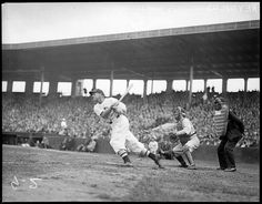 1934 - Red Sox batter Carl Reynolds driving one deep against unknown team at Fenway Park.