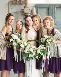 These bridesmaids fought the February chill with handmaid knit wraps over their eggplant chiffon gowns. See more of this real wedding in South Carolina by following the link!
