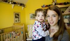 """Brooke Greenberg, left, is 16 years old in this photo. Her younger sister Carly (13) holds her. Brooke suffered from """"Syndrome X"""", an unknown affliction that forced her to remain the size of a toddler her entire life. She died on October 24, 2013 at the age of 20."""