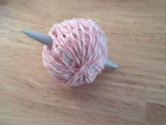 Neat trick for making tidy, usable, yarn balls.
