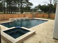 Pool and Spa with Raised Beam and 3 sheer descents, Custom Stamped Concrete.