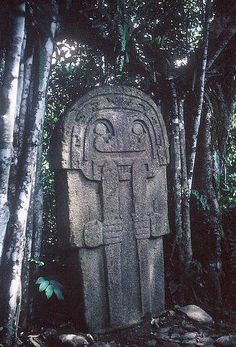 Ten-foot tall stone statue in jungle of southern Colombia at San Augustin.