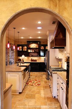 Looks like our Coastal Ivory Kitchen cabinets in a tuscan-style kitchen.  https://www.rtacabinetstore.com/RTA-Kitchen-Cabinets/coastal-ivory-kitchen-cabinets/