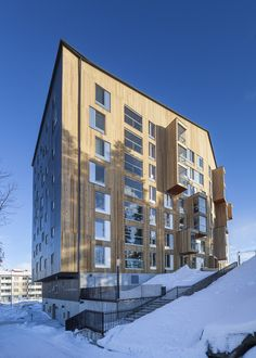 Built by OOPEAA in Jyväskylä, Finland with date 2015. Images by Mikko Auerniitty. Puukuokka is the first eight-story heigh wooden apartment building in Finland. Developed in collaboration with Lakea...