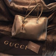 Authentic Gucci Like New Large handbag ⚜Gucci Stunning Large champagne colored leather handbag. This is absolutely exquisite. One owner non smoker   Beautiful details with the braided handles, bamboo tassels and gold hardware. Used about 2 times and in excellent condition no stains or wear. Linen interior with lots of pockets. Comes with dust bag. Gucci Bags