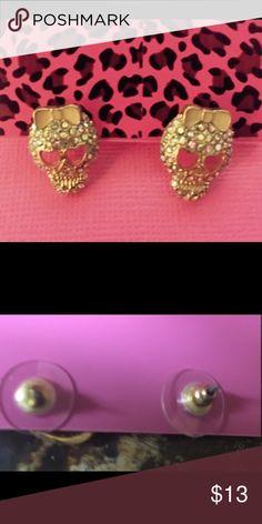 Darling skull earrings Gold tone, iridescent rhinestones which make these skulls bling. Jewelry Earrings