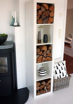Make your space feel like a cozy cabin with this IKEA Billy fire wood storage hack.