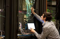 IT expert working on computer server equipment stock photo