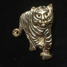 Pendant / Pin gold tone. Pendant / Pin gold tone. Never been worn. Great for Auburn Or LSU  team spirit Jewelry Necklaces