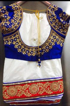 White Saree with heavy red border teamed with contest blue embroidered blouse