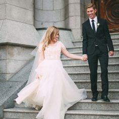 flowy modest wedding dress with blush lace from alta moda bridal (utah)