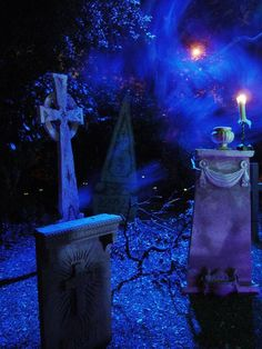 Love everything; tombstones, little eyes in the bushes, fog, lighting...Halloween Forum member AuraofForeboding
