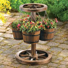Buy Wagon Wheel Planter at wholesale prices. We offer a large selection of cheap Wholesale Garden Planters. If you need Wagon Wheel Planter in bulk at a discount price then buy from WholesaleMart. Outdoor Decor, Wooden Wheel, Rustic Gardens, Wagon Wheel Garden, Garden Decor, Outdoor Gardens, Wood Barrel Planters, Rustic Planters, Yard Decor