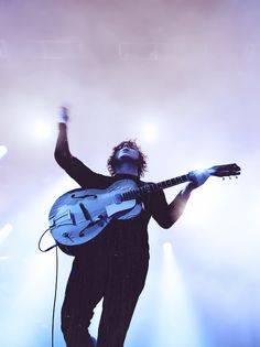 Jack White and his Kay.  I have the same guitar, but he converted his into an acoustic-electric. <3