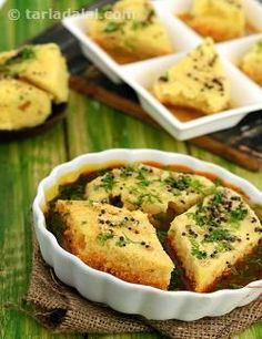 If you have enough dhoklas on hand, then this delectable one-dish meal can be prepared quite fast! rasawala dhokla is nothing but khaman dhoklas soaked in a sweet and spicy rasa (a thin sauce). Add the dhoklas to the rasa and simmer it just before serving, to ensure that the taste, look and feel of the dish is perfect.