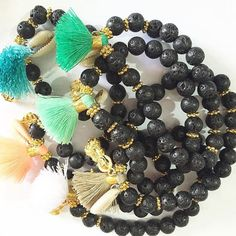 Lava stone bracelets! Gorgeous bracelets with lava stone and brass beads.Baby shells  detail and adding a tassel in cotton - available in any colour  #bracelets#beads#lavastone#stones#shell#ocean#surf#sea#sand#holidays#accessories#tropical#hamiltonisland#greatbarrierreef#queensland#surfparadise#fiji#holidays#Melbourne#barefoot#boho#style#hippie#chic#fashion#jewell#earrings#tassels#pompom by javaspiritaustralia http://ift.tt/1UokkV2