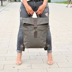 Backpack Rucksack UNISEX khaki with brown leather The backpack bag is sporty, cool and casual. The bag is made from canvas and oiled leather. The material is water resistant and it gets...
