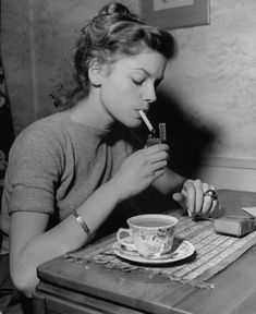 Lauren Bacall takes a coffee and cigarette break in the late '40s, back when cigarettes were good for you.
