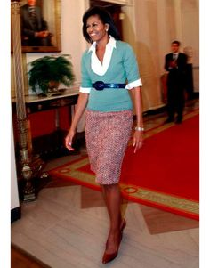 February 2009 - Obama looked warm and approachable in her colorful J. Crew skirt as she greeted Washington, DC, schoolchildren for a performance at the White House.