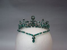 """Stunning green emerald headpiece suitable for all """"Esmeralda"""" tutus. Built on a silver base and entirely hand crafted, this professional tiara features green and clear crystals. A must to have when bu"""