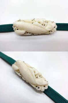 Antique koi fish shaped ornament worn over an obi, made by white coral.