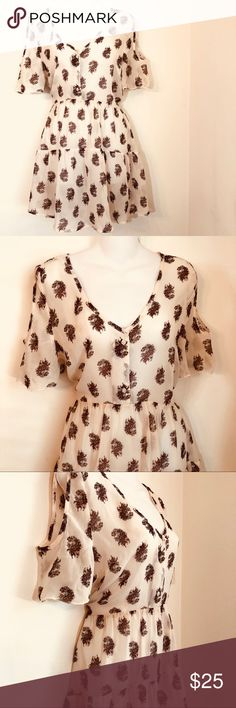 Band of gypsies |  cream sheer cold shoulder top Band of gypsies sheer  cream  100% polyester   maroon paisley print  cold shoulder top  back see-through  button front Tie back  Size large  Approximate measurements  length 33  pit to pit 20 1️⃣ Band of Gypsies Tops
