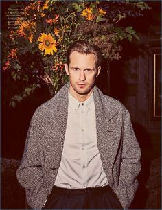 Front and center, Alexander Skarsgård rocks a Versace shirt with Ermenegildo Zegna Couture trousers, and a herringbone coat by Burberry.