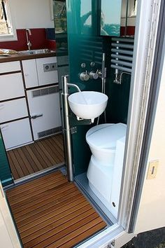"""Follow link 4 multiple pix showing this 3/4 bath in RV entrance. Sink basin swings away from toilet, entire bath is also a shower, in European terms a """"wet"""" bath"""