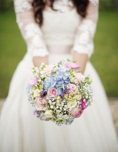 hydrangea, roses, gypsy pink, lisianthus, salvia(?)