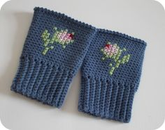Cross stitch on crochet wristycuffs.