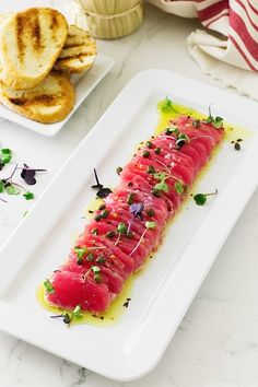 Tuna Crudo appetizers are delicate slices of raw tuna, drizzled with a light lemon vinaigrette and served with cucumber slices in Belgian endive boats. Tuna Sashimi Recipe, Ceviche Recipe, Sushi Recipes, Seafood Recipes, Cooking Recipes, Freezer Recipes, Freezer Cooking, Cooking School, Drink Recipes