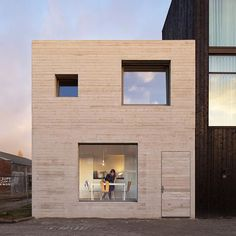 Dutch office Studio MAKS has built a compact concrete house in the old industrial harbor of Deventer. Photo by Christian van der Kooy