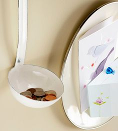 Savvy Serving Pieces  Old enamelware serving pieces -- placed on a wall near an entryway or in a home office -- can conveniently accommodate notes and coins. An enamel plate can function as a one-of-a-kind magnetic board for lists and reminders while a ladle catches spare change.